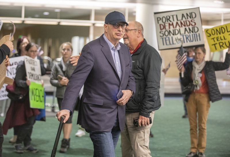 PMG PHOTO: JONATHAN HOUSE - Portland businessman-turned-impeachment-witness Gordon Sondland was met by protesters in November when he flew into Portland International Airport.