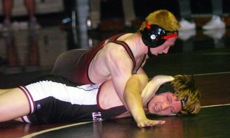PMG PHOTO: DAN BROOD - Sherwood High School senior Bram Nelson (top) is in charge in his 152-pound match with Glencoe's Jacob Keltner. Nelson won the match by fall.