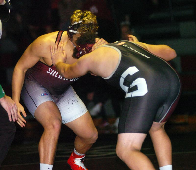 PMG PHOTO: DAN BROOD - Sherwood High School junior Bryan Cuthbertson (left) gets ready to lock up with Glencoe's Spencer Krussman in the 220-pound match. Cuthbertson won by fall in 19 seconds.