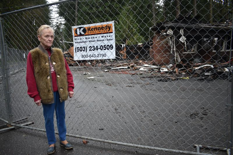 PMG PHOTO: SHANNON O. WELLS - Shirley's Tippy Canoe owner Shirley Welton on Friday, Feb. 7, stands outside what little is left of the restaurant and lounge she spent $600,000 to refurbish in 2007. A fire quickly destroyed the two-story structure the morning of Friday, Jan. 17.