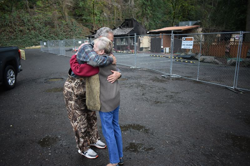 PMG PHOTO: SHANNON O. WELLS - Tippy Canoe owner Shirley Welton gets a comforting hug from Peter Buzikovich, a longtime friend and neighbor of Weltons restaurant on Historic Columbia River Highway.