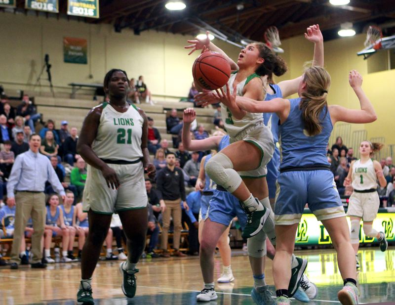PMG PHOTO: MILES VANCE - West Linn's Alana Molden gets fouled by Lakeridge's Reese Ericson during the Lions' 71-57 win on Friday, Feb. 7, at West Linn High School.