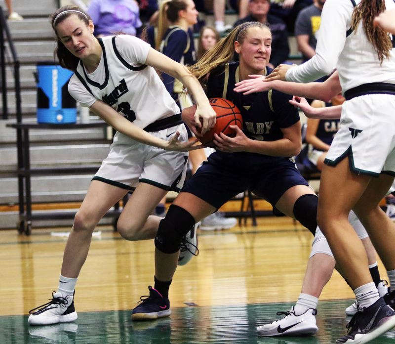 PMG PHOTO: DAN BROOD - Tigard High School freshman Karen Spadafora (left) and Canby senior Ally Odell battle over the ball during the Cougars' 51-40 win in Friday's game.