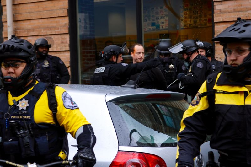 PMG PHOTO: ZANE SPARLING - Brandon Michael Farley was arrested on a second-degree disorderly conduct charge during a protest in Portland on Saturday, Feb. 8.