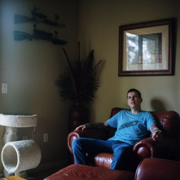 OPB PHOTO - Josh Haggard sits for a portrait in his living room on Jan. 24, 2020, in Portland, Ore