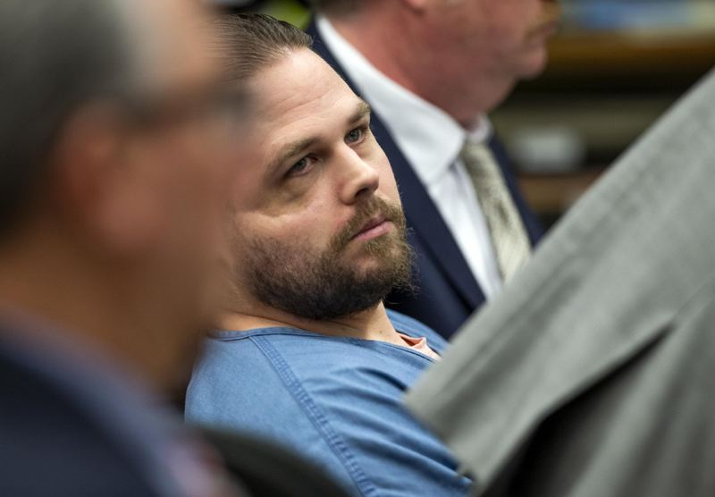 DAVE KILLEN/THE OREGONIAN/OREGONLIVE/POOL - Jeremy Christian in court with his defense attorneys.