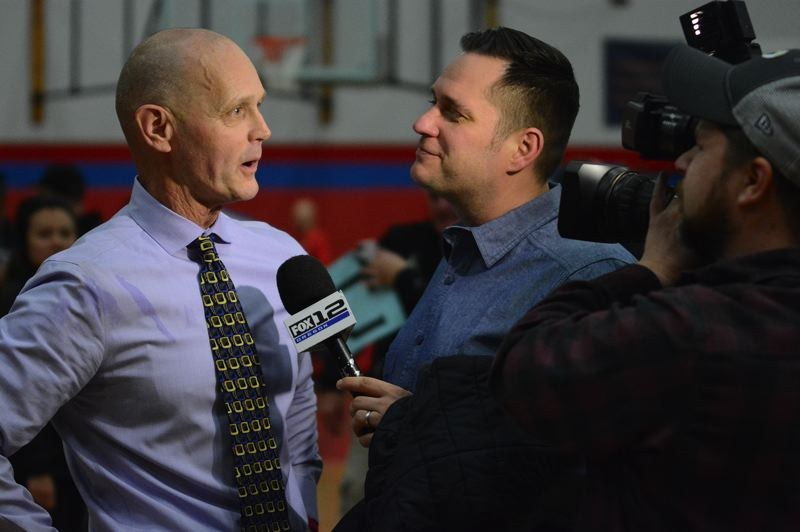 PMG PHOTO: DAVID BALL - Barlow head coach Tom Johnson talks with FOX-12s Nick Krupke following his milestone 600th career victory Friday night at Centennial.