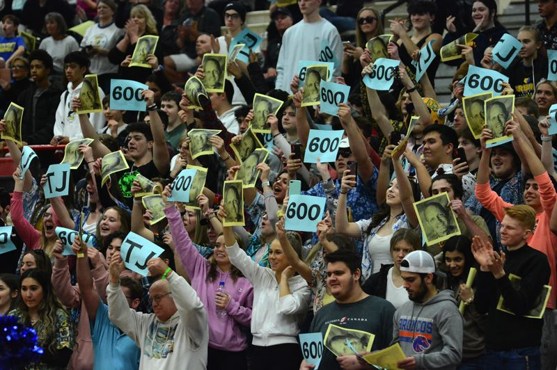PMG PHOTO: DAVID BALL - Barlows Superfans turned packed the opposing gym to celebrate Fridays 62-48 win at Centennial.