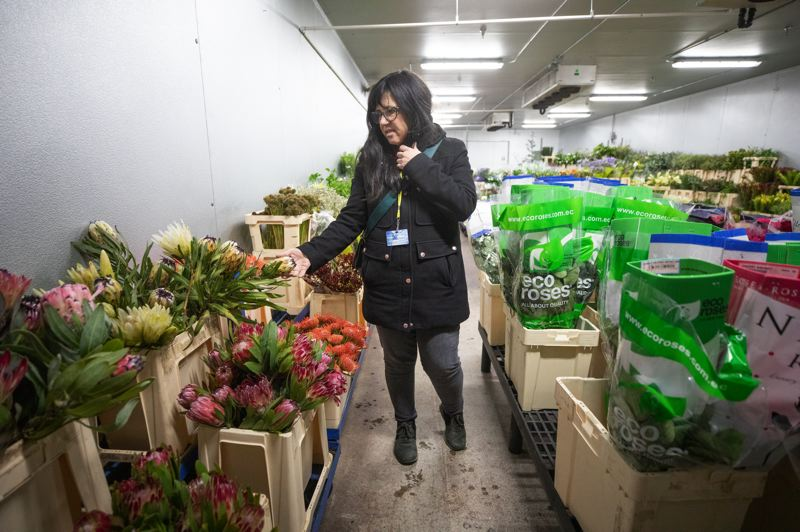 PMG PHOTO: JONATHAN HOUSE - Florist Staci Gundry, owner of Bodle Frog Botanical, shops at the Portland Flower Market on Swan Island. She is diversifying into dried flower art pieces to balance out the instability of the fresh flower business.