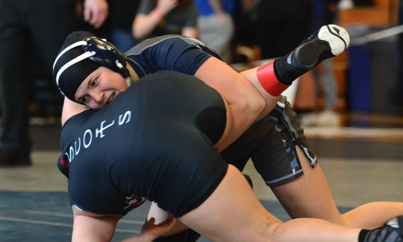 PMG PHOTO: DEREK WILEY - Canby junior Havyln Ehrich needed only 36 seconds to pin David Douglas' Eh Nay Paw and advance to the consolation semifinals Saturday at Century High School in Hillsboro.