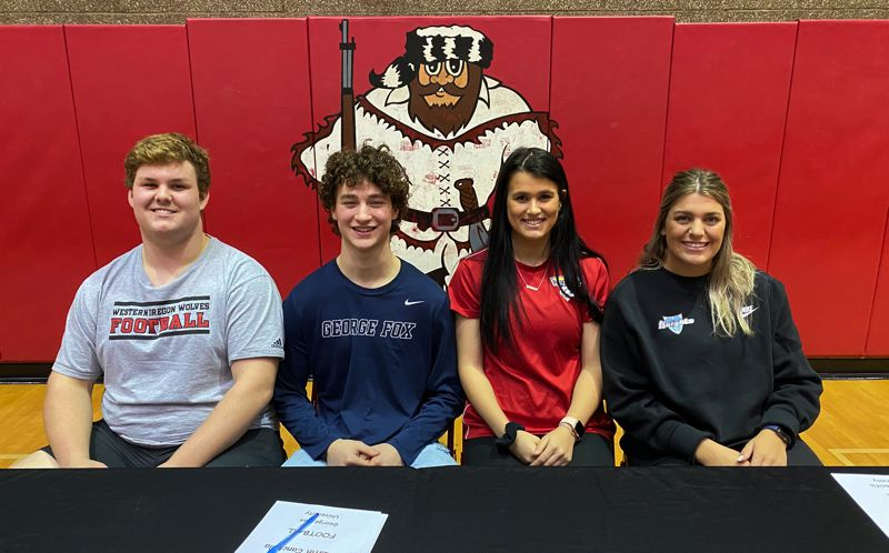 PMG PHOTO: JIM BESEDA - Oregon City High School student athlets (right to left) Zach Zumwalt, Austin Canchola, Carissa Feliciano, and Abi Willett were recognized during Wednesdays National Signing Day ceremonies in the high school gym.