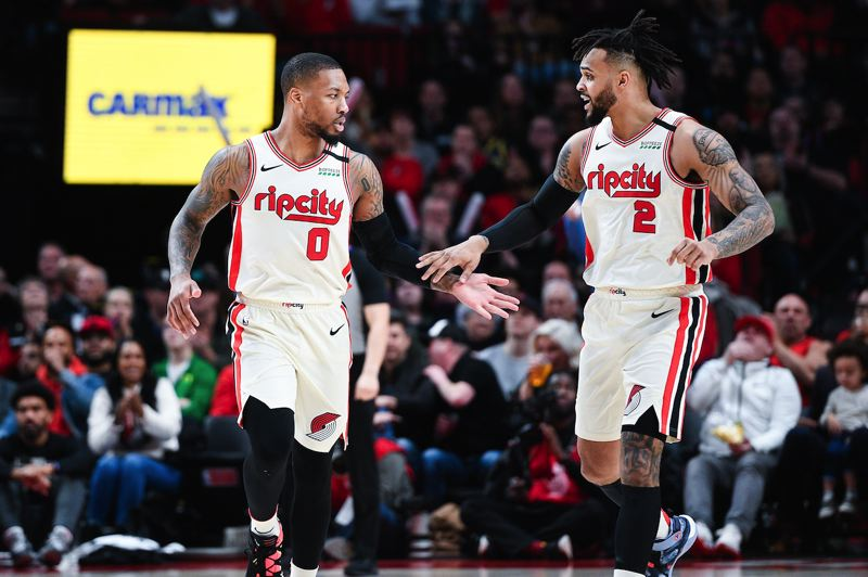 PMG PHOTO: CHRISTOPHER OERTELL - Gary Trent Jr. (right) and Damian Lillard of the Trail Blazers connect on their way back down the court Sunday night as Portland defeats Miami at Moda Center.