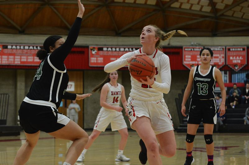 PMG PHOTO: DAVID BALL - Mt. Hood CC center Emily Webber makes a move to the basket during the Saints 54-39 home win over Chemeketa on Saturday.