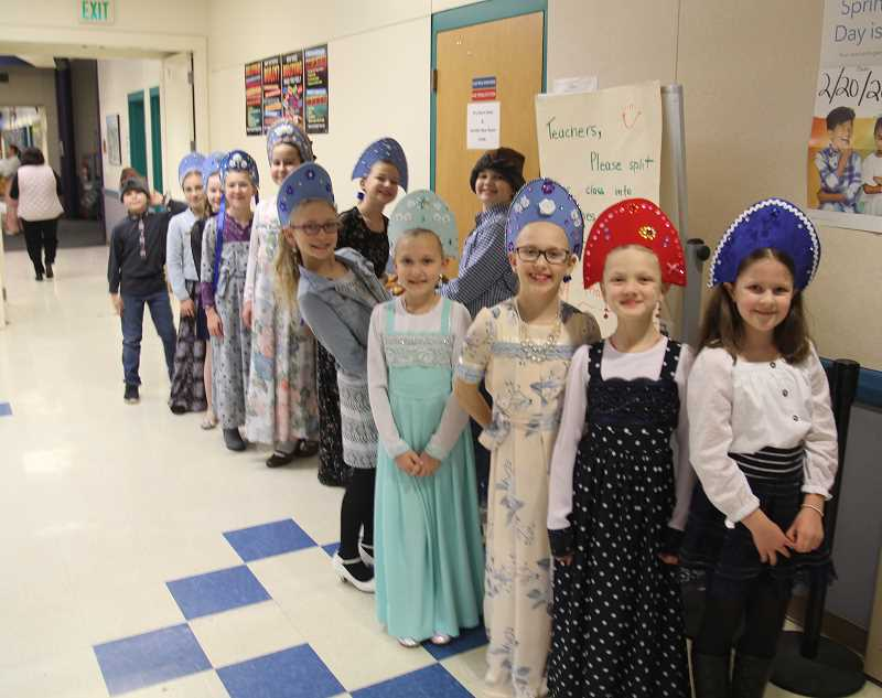 PMG PHOTO: JUSTIN MUCH - Alexandra Kichatovs fourth graders don traditional Russian headwear — the girls with kokoshniks and boys in kolpaks — prior to performing The Wolf and the Seven Young Kids during the Russian Winter Festival Thursday, Feb. 6, at Heritage Elementary School.