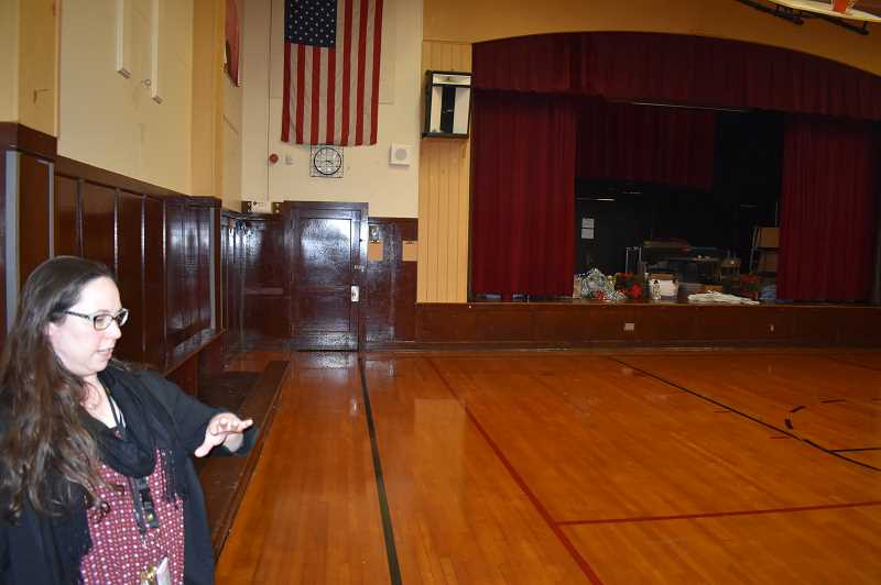 PMG PHOTO: RAYMOND RENDLEMAN - New Urban High School Principal Andrea Lockard tours the school's old gymnasium.