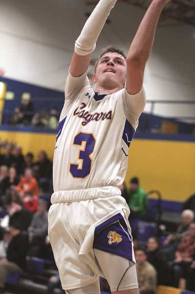 PMG PHOTO: PHIL HAWKINS - Gervais junior Michael Toran scored a game-high 19 points and connected on three 3-pointers in the Cougars 53-43 win over Colton on Wednesday, Feb. 5.