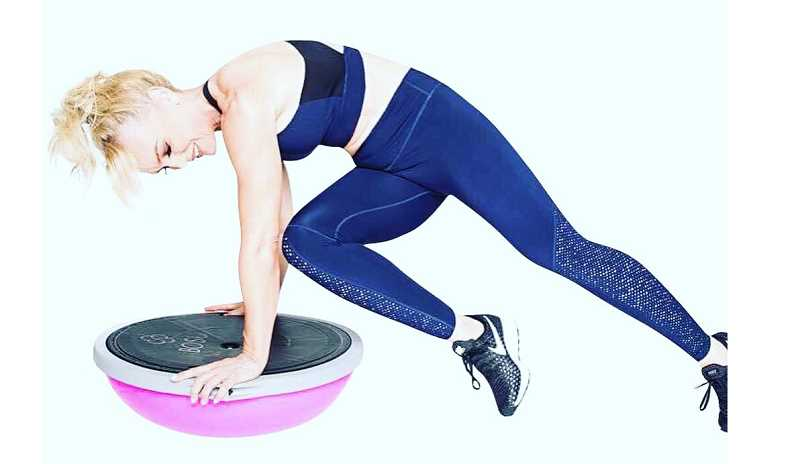 COURTESY PHOTO - Bobbi Parker Hall, CEO of Modern Bodies Fitness, uses a balance trainer to develop core strength.