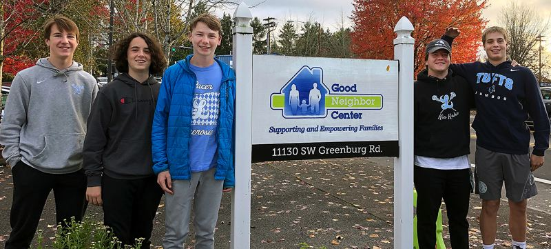 COURTESY PHOTO LAKERIDGE LACROSSE - Members of the Lakeridge boys lacrosse team pose outside the Good Neighbor Center in Tigard after dropping off collected donations to families experiencing homelessness.