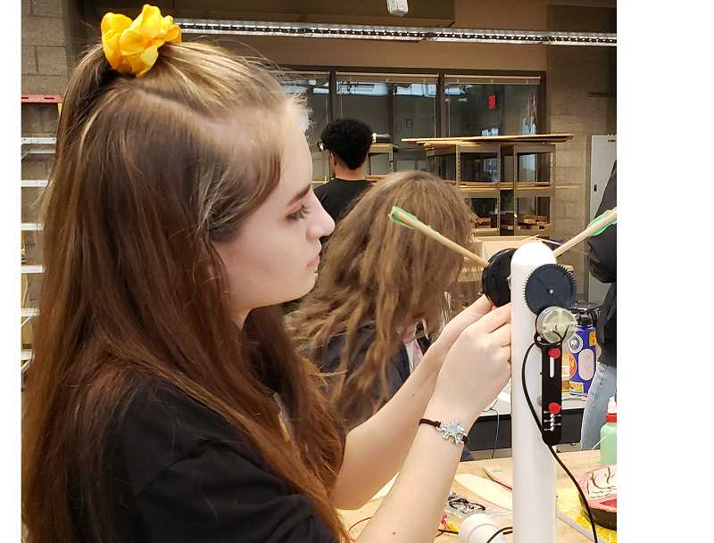 COURTESY PHOTO - Gladstone High School freshman Jasmine Morris-White tests a wind turbine she constructed in a new class designed to give students a broad foundation in technology skills.