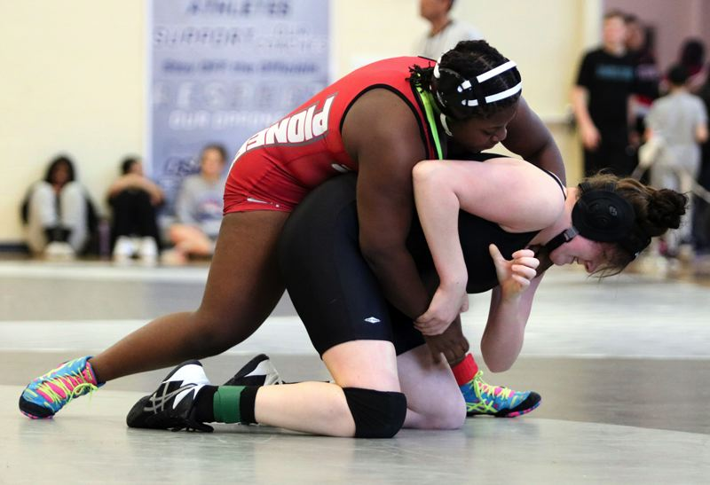 PMG PHOTO: JIM BESEDA - Sandys Olivia Willard won by first-round fall over Warrentons Jade Vollner for third place at 190 pounds in last weekends North Region womens wrestling tournament.