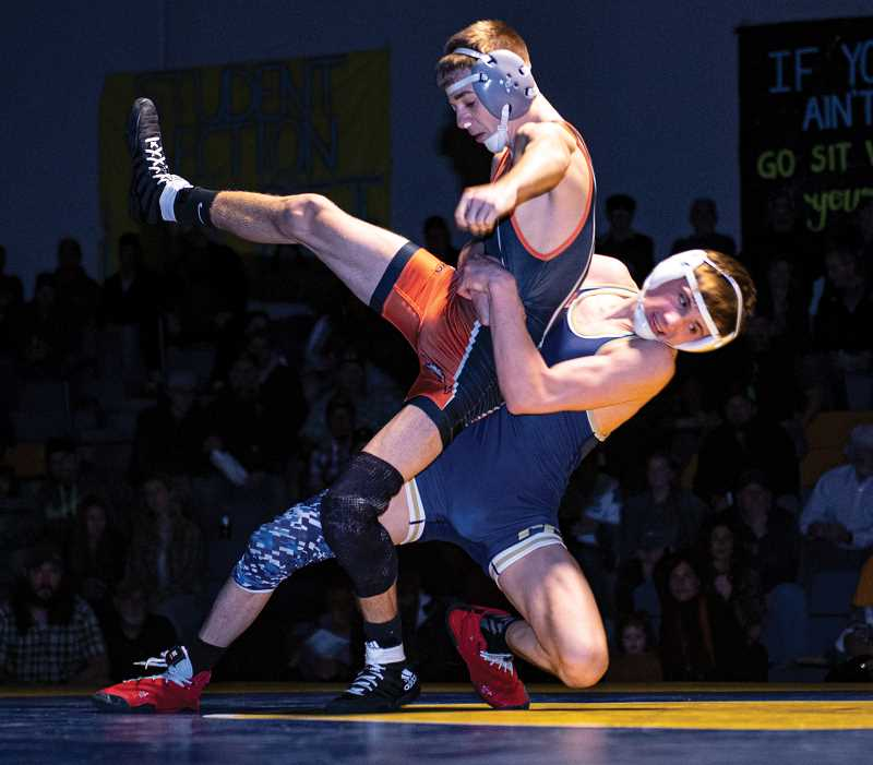 LON AUSTIN/CENTRAL OREGONIAN - Cash Wells works to return Roseburg's Cameron Cross to the mat during their 113-pound match. Wells, a freshman, pinned Cross, a senior, late in the second round of their match. However, Roseburg won the dual 40-34.