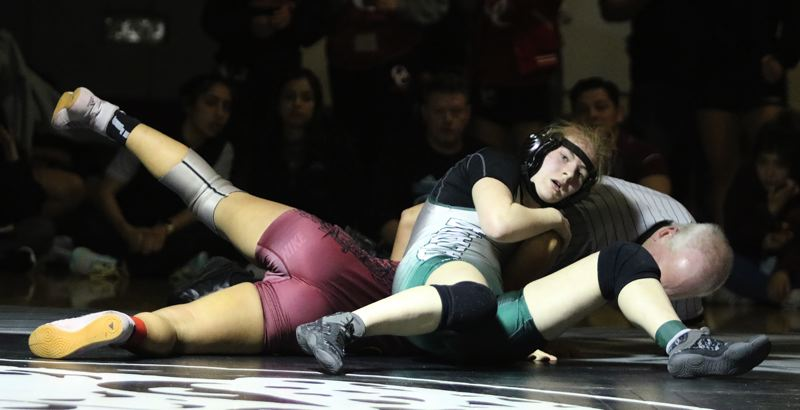 PMG PHOTO: JIM BESEDA - Estacadas Dana Glasser won by second-round pin over Forest Groves Makaila Takahashi in the 130-pound final at the North Region tournament.