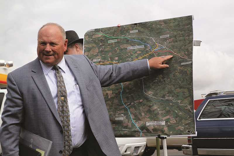 PMG FILE PHOTO - Marion County Commissioner Sam Brentano discusses traffic issues with transportation officials in 2016 while the Newberg-Dundee bypass was under construction. Some river crossings spawn road-safety and freeway-access issues.
