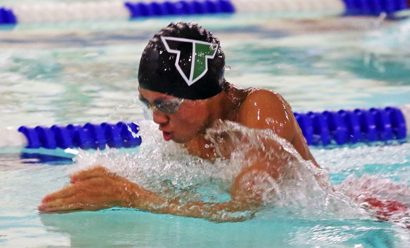 PMG PHOTO: DAN BROOD - Tigard High School junior Jaden Nguyen is on his way to victory in the 100-yard breaststroke event during the Tigers' meet at Tualatin.