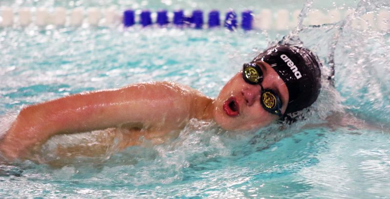 PMG PHOTO: DAN BROOD - Tualatin High School freshman Colton Hof triumphed in the 500-yard freestyle event during the Timberwolves' Three Rivers League dual meet with Tigard.