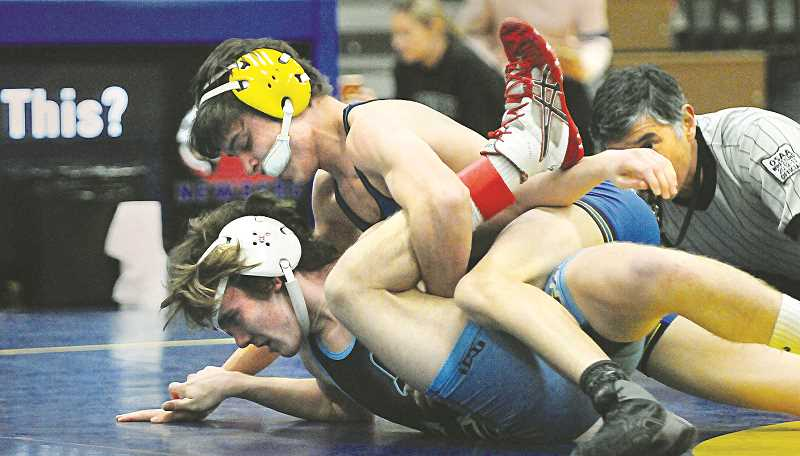 GRAPHIC PHOTO: GARY ALLEN - Newberg made quick work of Liberty last week in anticipation of districts this weekend.