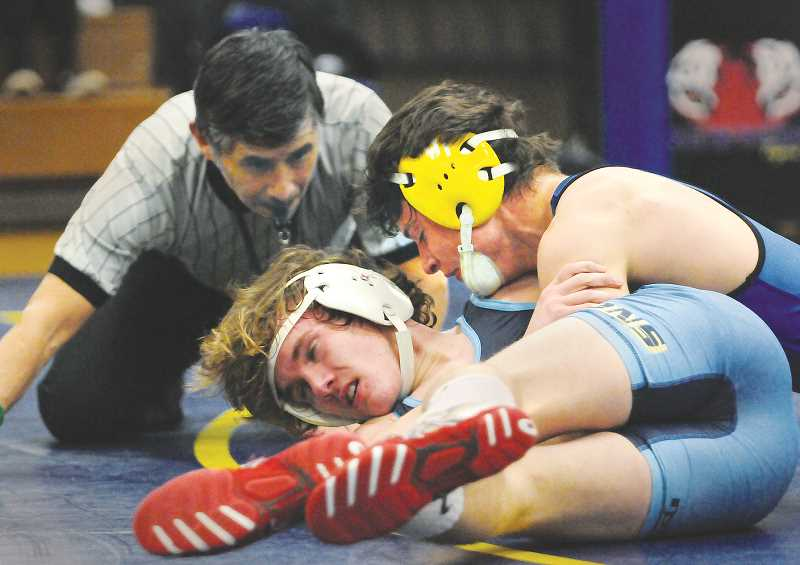 GRAPHIC PHOTO: GARY ALLEN - NHS coach Neil Russo says his ultimate goal is to put two wrestlers in every weight class at districts this weekend to earn as many sports as possible for state.