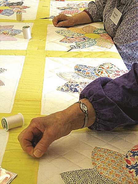 PMG FILE PHOTO - Guests of all experience levels are invited to Zion Mennonite Church on Feb. 20-22 for the 48th annual Quilting Workshop. Participants can learn the basics about quilting from trained volunteers and can receive hands-on practice.