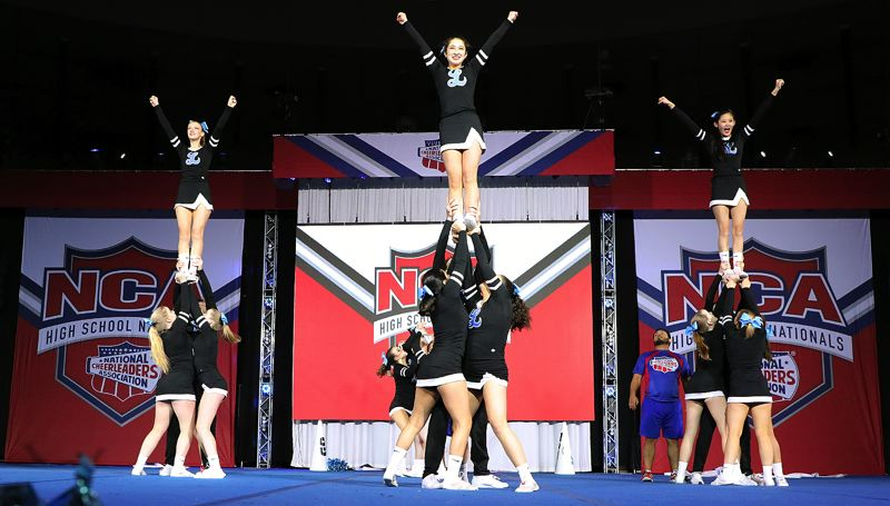COURTESY PHOTO LAKERIDGE CHEER - The Lakeridge coed cheer team competes in the NCA nationals in Dallas, Texas, from Jan. 30-Feb. 3. The Pacers finished second in the Large Intermediate Game Performance division.