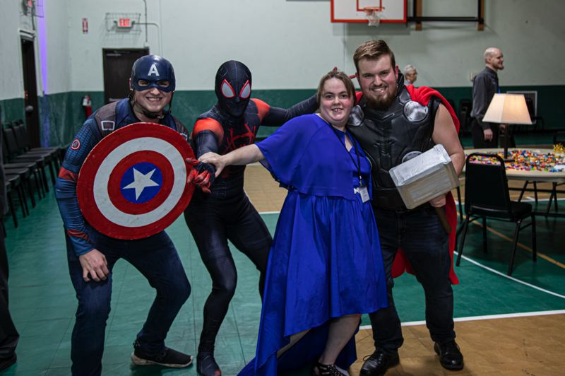 COURTESY PHOTO: DIANE CARBONE, AT HOME PLATE PHOTOGRAPHY - Attendees of the Night to Shine gathering in Estacada strike a superhero pose.