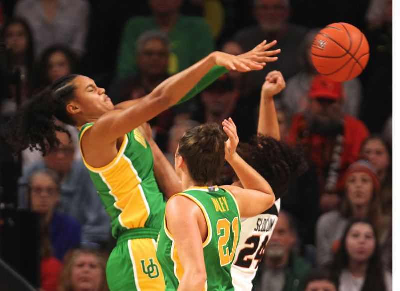 PMG PHOTO: JAIME VALDEZ - Defense by players such as Satou Sabally (left) has helped Oregon surge in womens basketball