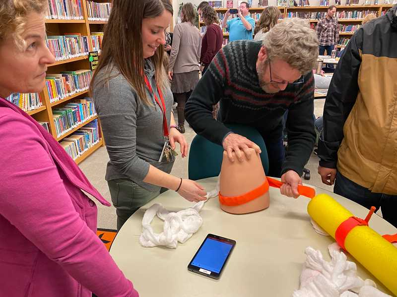 COURTESY PHOTO: BRAD KUHN - Staff at Molalla River Academy learn to use a tourniquet during a training event in January.