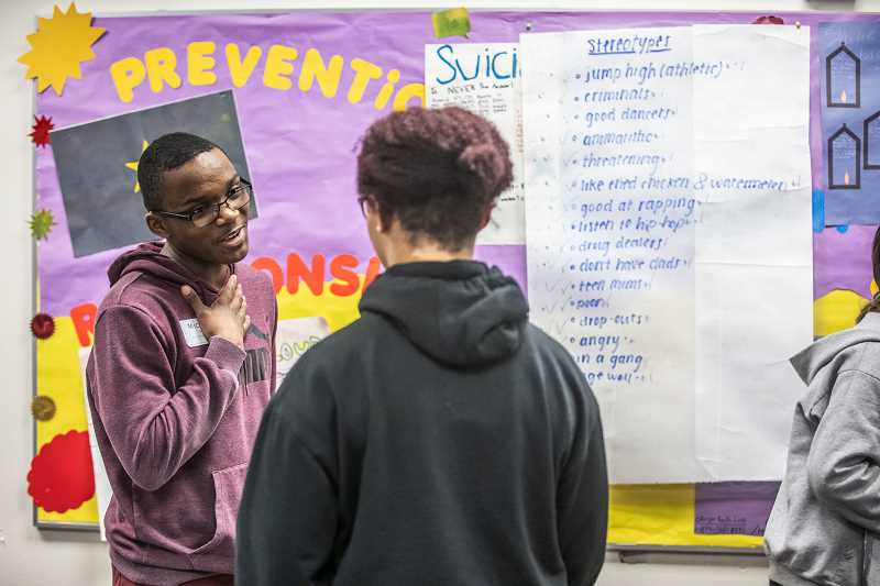 PMG PHOTO: JONATHAN HOUSE - Michael Musangu shares his opinions during an exercise on stereotypes at the 'Tackling Our Implicit Bias in Order to Have a Conversation About Race,' breakout session in Beaverton.