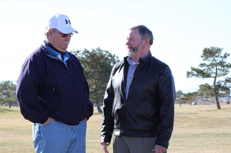 TERESA JACKSON/MADRAS PIONEER - Bob Ringering, left, and Mayor Richard Ladeby meet at Desert Peaks Golf Course in Madras. When Ladeby collapsed on the course in May, Ringering used CPR to save his life.
