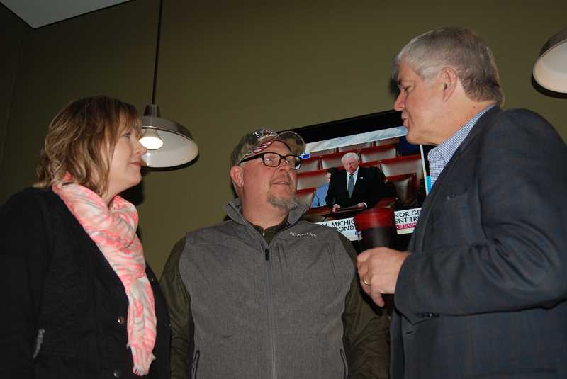 TERESA JACKSON/MADRAS PIONEER - Laura and Lyle Rehwinkel talk with Cliff Bentz, who is running to represent Oregon's 2nd District in the U.S. House of Representatives. The meet and greet was at Madras Brewing Co. on Tuesday, Feb. 7.