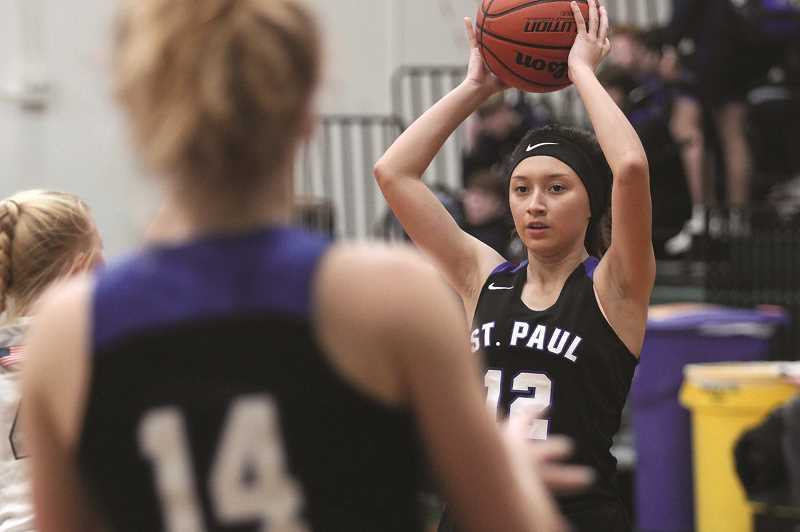PMG FILE PHOTO: PHIL HAWKINS - Diana Hernandez and the St. Paul girls basketball team moved back into the No. 1 slot in the OSAA standings after beating No. 7 Mohawk 45-36 on Monday night.