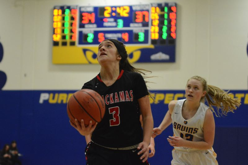PMG PHOTO: DAVID BALL - Clackamas guard Bella Garcia breaks through the lane for a layup in the third quarter of the Cavaliers 53-50 win at Barlow on Tuesday.