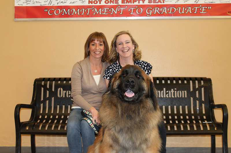 PMG PHOTO: HOLLY BARTHOLOMEW - Melanie Nelson (left) and Otto helped bring smiles to Oregon City High School after the death of a student. Assistant Principal Stacy  Erickson was grateful for everyone who supported the school.