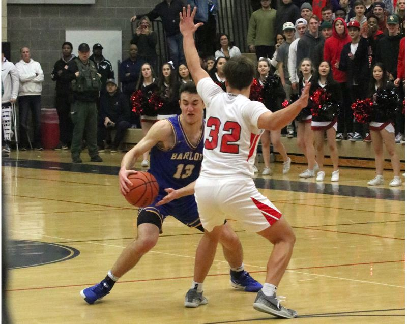 PMG PHOTO: JIM BESEDA - Barlow's Evan Inglesby (13) makes a hard move to his right and away from Clackamas' Jackson Jaha (32) before launching a 3-pointer that sent Tuesday's Mt. Hood Conference game to overtime.