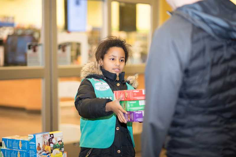 COURTESY PHOTO - Local Girls Scout troops have been selling cookies for more than a century. Proceeds from the sales go to support local troops.