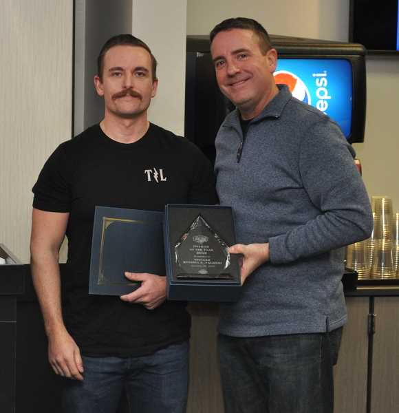 COURTESY PHOTO - Officer Rusty Palmeri, left, pictured with Jay Weitman with the LOPD, received the Officer of the Year award.