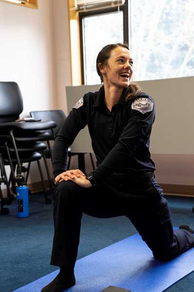 PMG PHOTO: CLARA HOWELL  - Ashley Dalton, with the LOPD, participates in a yoga class before her shift starts.
