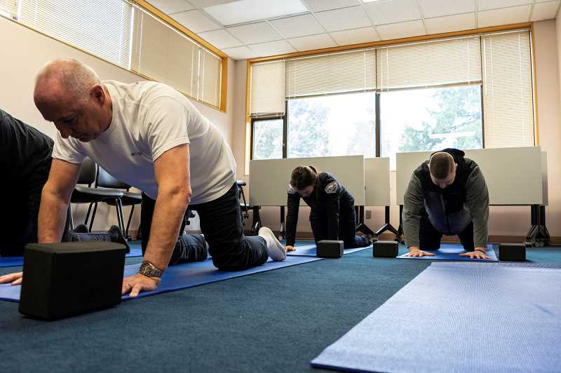 PMG PHOTO: CLARA HOWELL  - LOPD officers focus on wrist, hip and back mobility, while learning new breathing techniques.