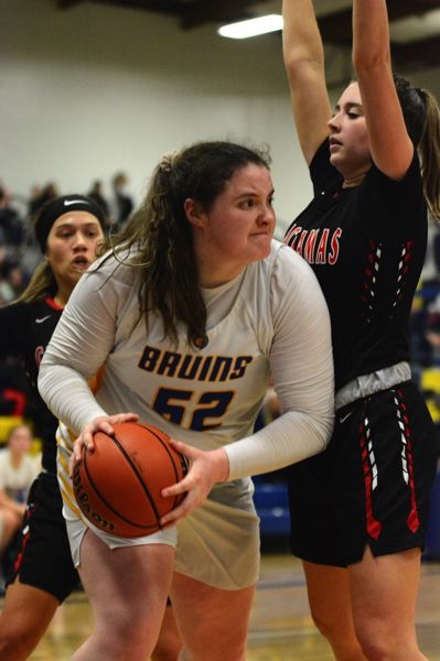 PMG PHOTO: DAVID BALL - Barlow center Libby Mathis looks to make an exit pass after getting trapped behind the basket in the fourth quarter.