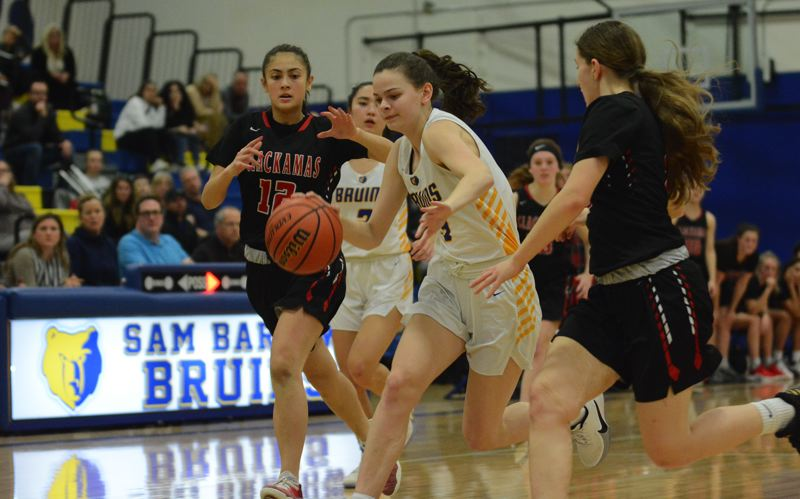 PMG PHOTO: DAVID BALL - Barlows Annie Koenig looks for a path to the basket after coming up with a steal in the second half of Tuesdays 53-50 loss to Clackamas.