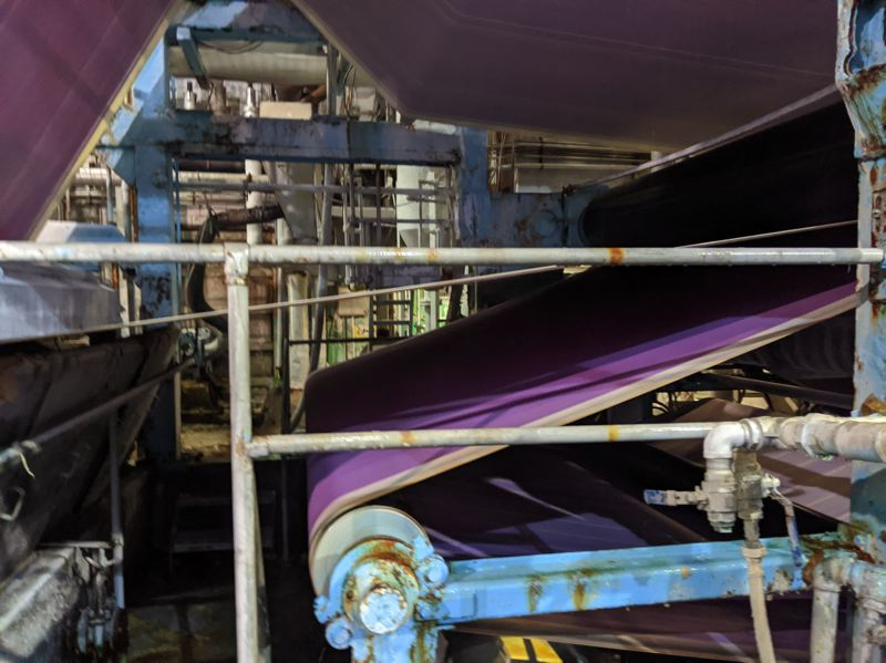 PAMPLIN MEDIA GROUP: JOSEPH GALLIVAN - The Purple belt at Machine Number 3 at Willamette Falls Paper Company in West Linn. It helps remove water at the beginning of the papermaking process.